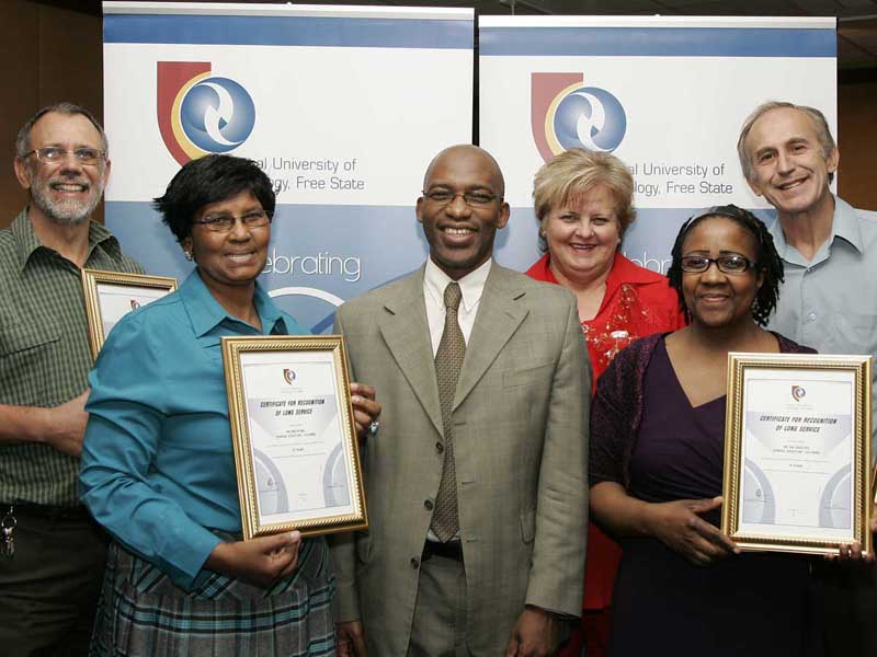 Staff members honoured for their huge contribution by Professor Thandwa Mthembu at Long Service Awards.