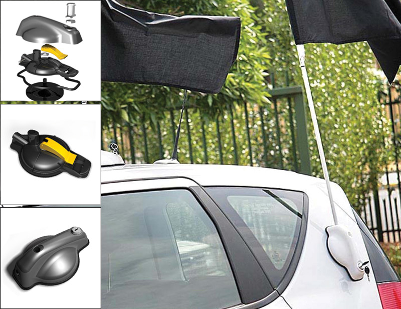 Flag Holder, designed to attach onto the body of a vehicle to position a flag.  The attachment of the device is achieved by means of a suction unit at the bottom.