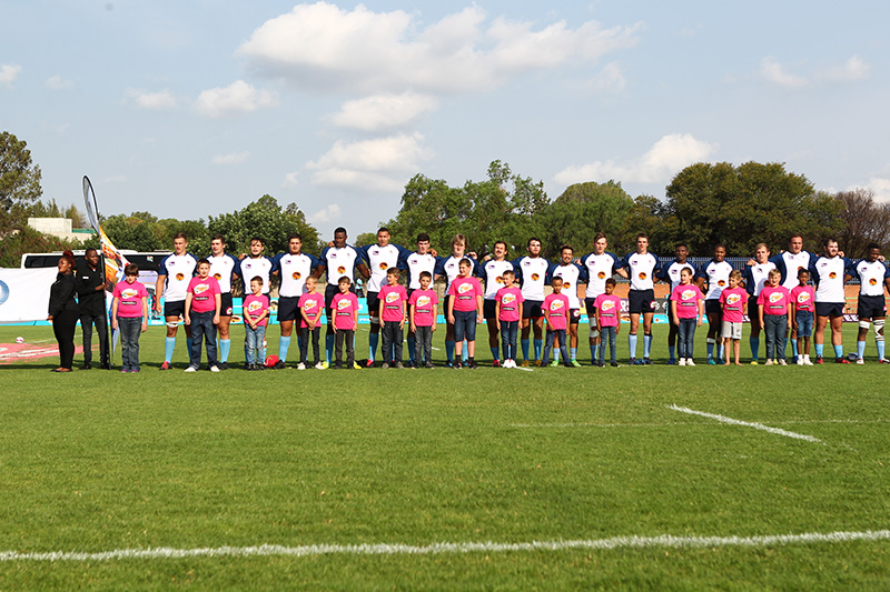 CUT team singing the national anthem during the Varsity Cup matc